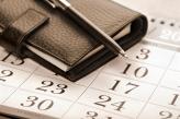 Calendar page, pen and pocket planner